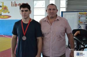 Vlad Caras, alaturi de antrenorul Adrian Dacica
