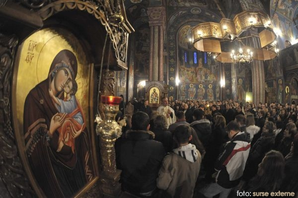 People attend a midnight Christmas service at the Orthodox Church of Sts. Cyril and Methodius in Ljubljana
