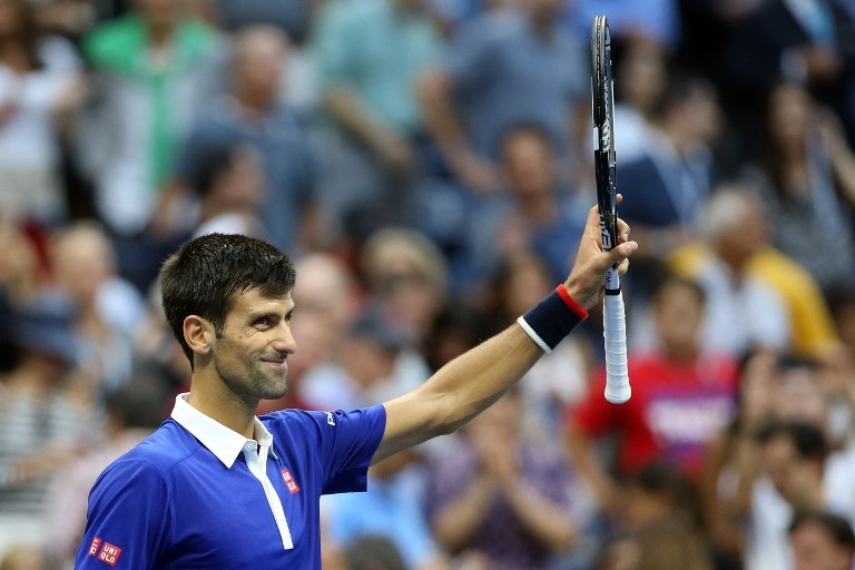 NEW YORK, NY - SEPTEMBER 11: Novak Djokovic of Serbia celebrates after defeating Marin Cilic of Croatia during their Men's Singles Semifinals match on Day Twelve of the 2015 US Open at the USTA Billie Jean King National Tennis Center on September 11, 2015 in the Flushing neighborhood of the Queens borough of New York City. Djokovic defeated Cilic 6-0, 6-1, 6-2.   Matthew Stockman/Getty Images/AFP