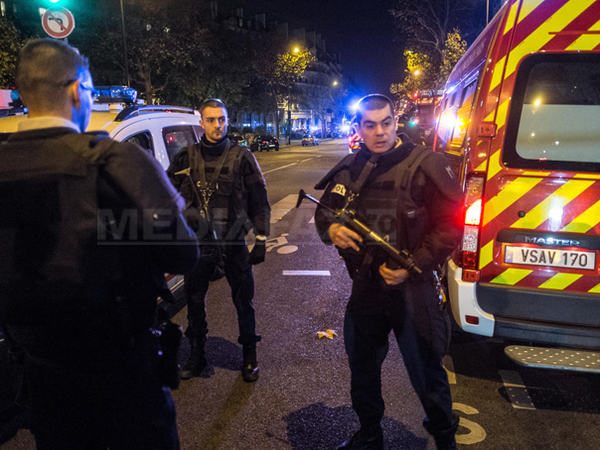 French police officers take security measures around the Bataclan concert hall (near Place de la Republique) in Paris, France on November 13, 2015, after deadly shootings and explosions took place in several neighbourhoods of Paris. French media quoted police as saying late Friday that around 100 people alone died in a gun battle at the Bataclan arts centre; two gunmen were also reportedly killed. Photo by Amine Landoulsi/AA/ABACAPRESS.COM